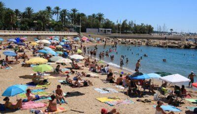 Tourists in a public beach in Cannes