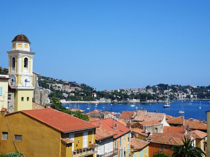 Red roofs of the stucco or brick houses and the campanile of the Église St-Michel, Villefranche-sur-Mer